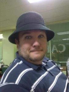 "Paul ""modeling"" Susan's hat"