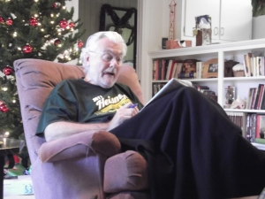 Dad working the crossword puzzle on Christmas Eve morning