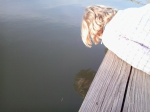 Hannah spitting in the pond to see if we could see fish
