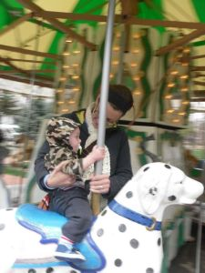 me helping Jeremiah on the Carousel