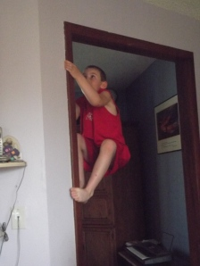 "Jacob ""scaling"" the wall at his house"