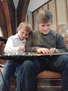 "Mason and Walker ""playing"" guitar together...."