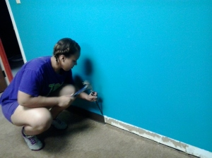 Jasmine ripping out baseboard