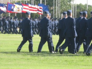 marching onto the field for graduation (2nd from the left)