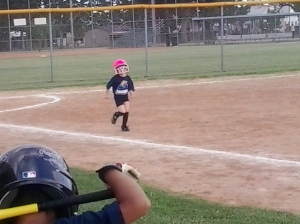 Brooklyn running in her last T-ball game