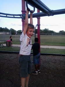 Heath playing on the playground