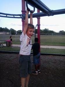 Heath playing on the playground