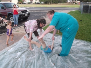 Gina and Erica helping the little ones slide