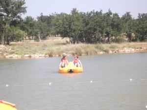 Morgan and Victoria paddleboating