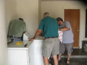 How many guys does it take to install a washer/dryer