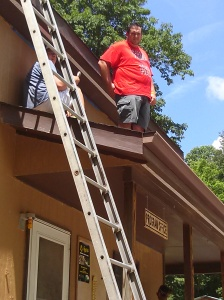 "Paul ""supervising"" from the roof"