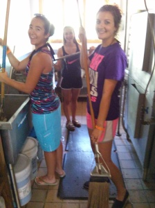 Emilie, Lauren, and Morgan cleaning