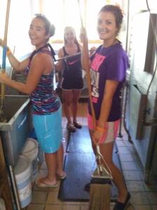 Emilie, Lauren, and Morgan cleaning