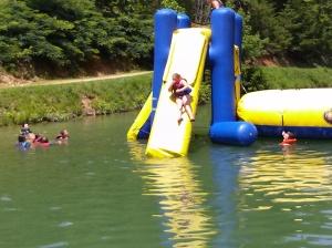 Grace going down the slide