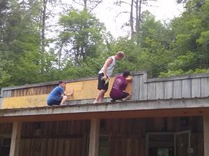 Kris and some of the other boys on the roof, replacing a sign