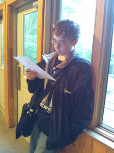 Clayton reading his notes