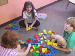 Perryn, Celine, and Holden sorting their Legos