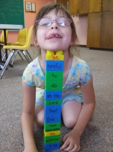 """Aislyn """"building"""" the memory verse"""