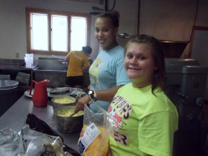 Jasmine and Macie making Mac and Cheese for dinner