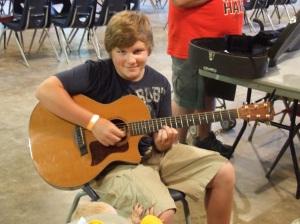 Walker playing guitar