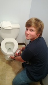 Walker cleaning the bathrooms
