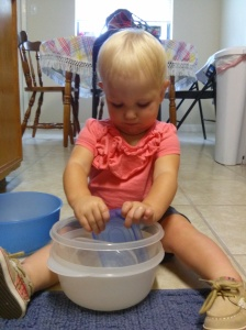 Aubrey playing with our Tupperware