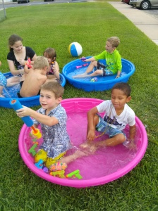 the kids playing in the baby pools