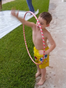 Damien trying tricks with the hula hoop