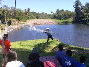 learning how to throw a net to go fishing