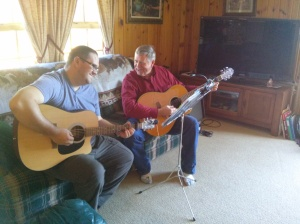 Randy and Paul, playing guitars