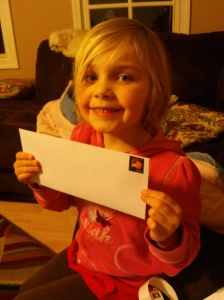 "teaching her where the ""sticker"" goes on the envelope!"